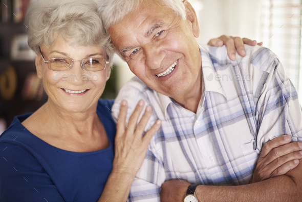 Portrait of cheerful senior couple - Stock Photo - Images