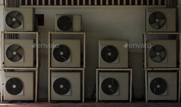 Lot of the old air conditioner compressors at wall of building - Stock Photo - Images