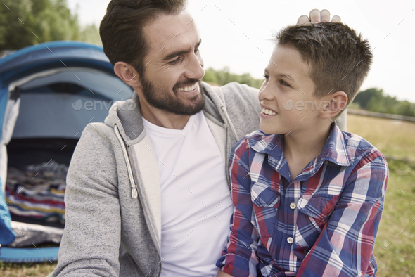 Man and his son on camping on weekend - Stock Photo - Images