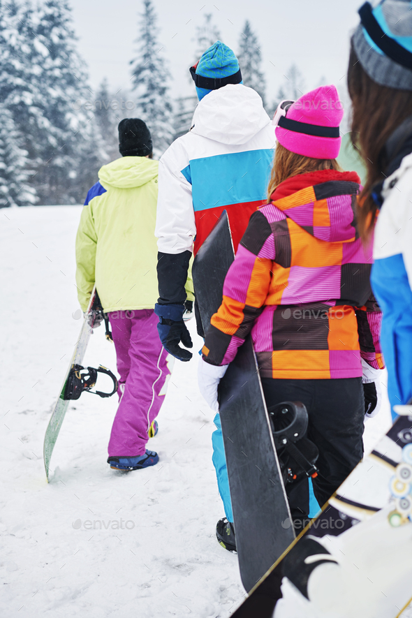 Climbing to mountain peak with snowboards - Stock Photo - Images