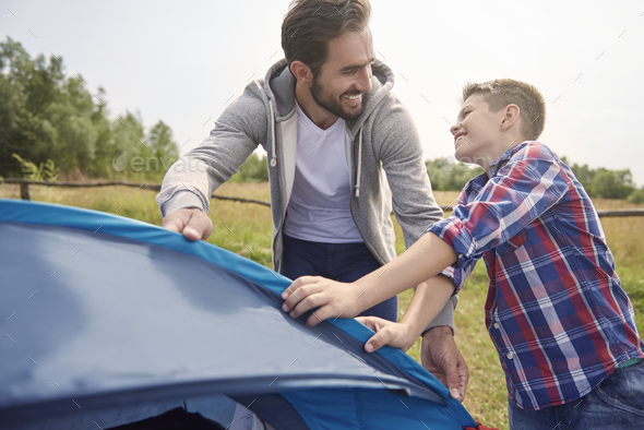 Even while pitching a tent we have fun - Stock Photo - Images