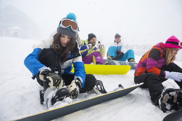 Women focused on clasping ski shoes - Stock Photo - Images