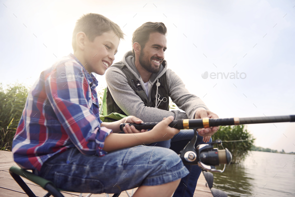 Fishing by the lake is our common passion - Stock Photo - Images