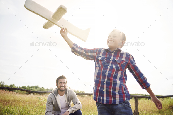 Father and son have fun during the playing - Stock Photo - Images