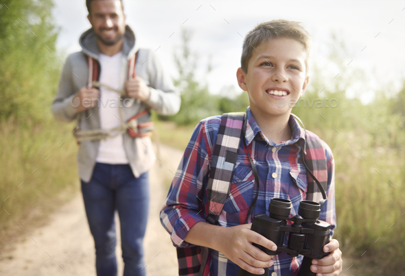 Boy discovering world with his father - Stock Photo - Images