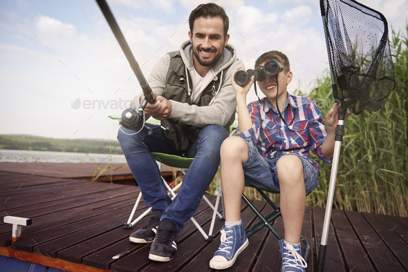 We are daddy about to catch this fish - Stock Photo - Images