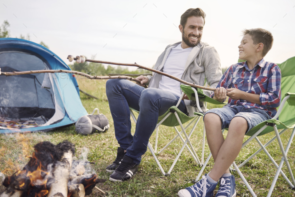 Little snack with my son on the camping - Stock Photo - Images