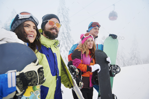 Great day with friends on snowboard - Stock Photo - Images