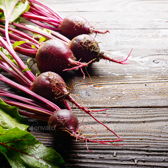 Fresh organic beetroots on kitchen wooden rustic table close up - Stock Photo - Images