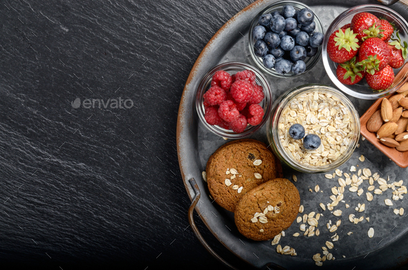 Flat lay view at vintage tray with ripe organic bilberry raspber - Stock Photo - Images