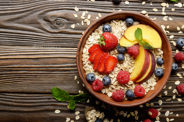 Flat lay of fruit healthy muesli with peaches strawberry almonds - Stock Photo - Images