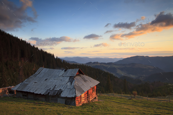 Old house in the mountains at dawn - Stock Photo - Images
