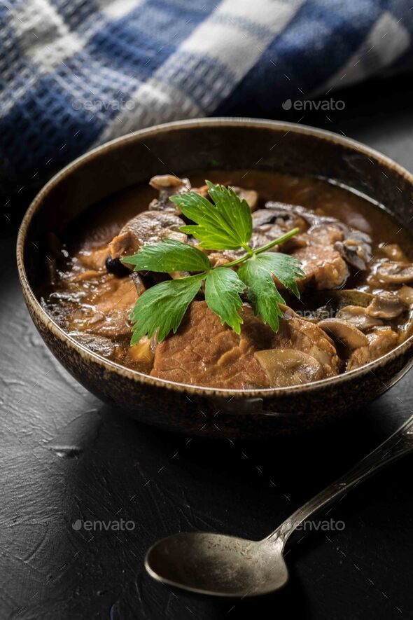 Stewed Pork Chop in a bright Mushroom Sauce. - Stock Photo - Images