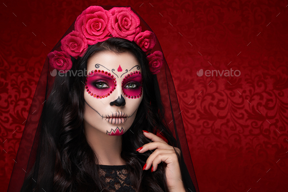 Portrait of a woman with makeup sugar skull - Stock Photo - Images