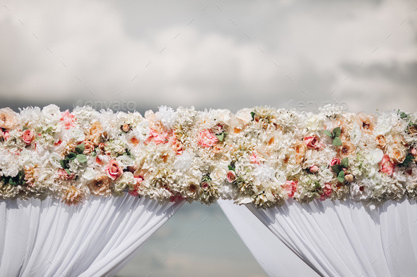 Close-up of wedding arch decorated with roses - Stock Photo - Images