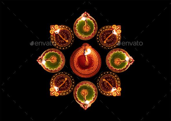 Happy Diwali. Diya oil lamps against dark background, - Stock Photo - Images