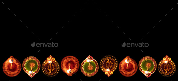 Diwali, Hindu festival of lights celebration. Diya oil lamps against dark background, - Stock Photo - Images