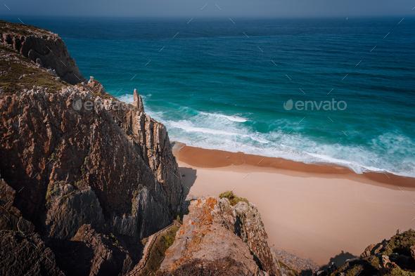 Rocky cliffs at praia grande at Atlantic ocean, Sintra, Portugal, Europe - Stock Photo - Images
