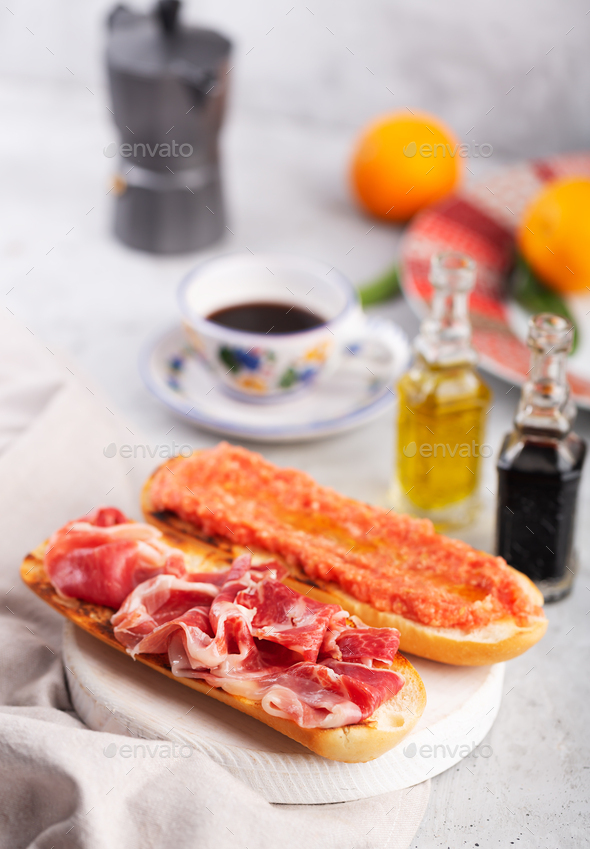Spanish tomato and ham toast, traditional breakfast or lunch with coffee - Stock Photo - Images