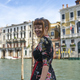 Caucasian redhead woman with floral dress looking at grand canal Venice smiling - PhotoDune Item for Sale