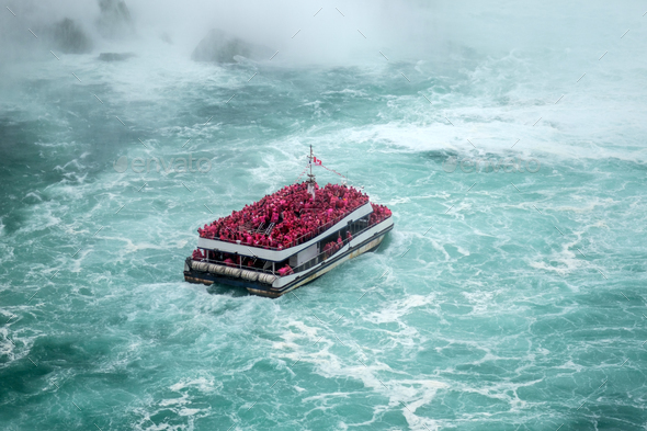 Ferry approaching the famous Niagara Fall - Stock Photo - Images