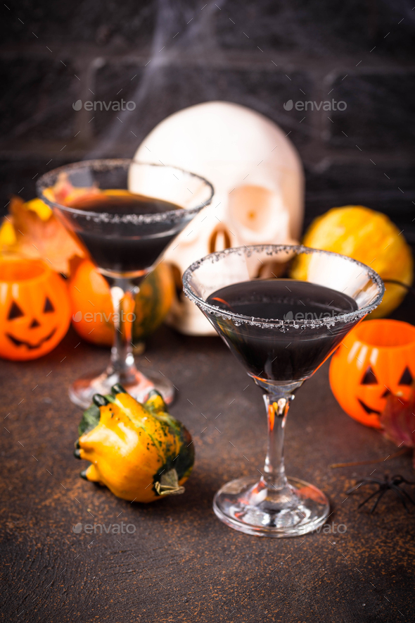 Halloweens spooky drink black martini cocktail - Stock Photo - Images