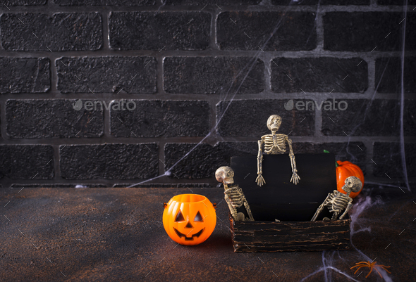 Halloween background with skeletons and tomb - Stock Photo - Images
