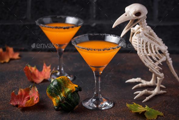 Halloweens drink pumpkin martini cocktail - Stock Photo - Images