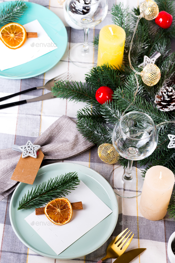 Festive Christmas and New Year table setting with dry orange and cinnamon on a gray textile. Dining - Stock Photo - Images
