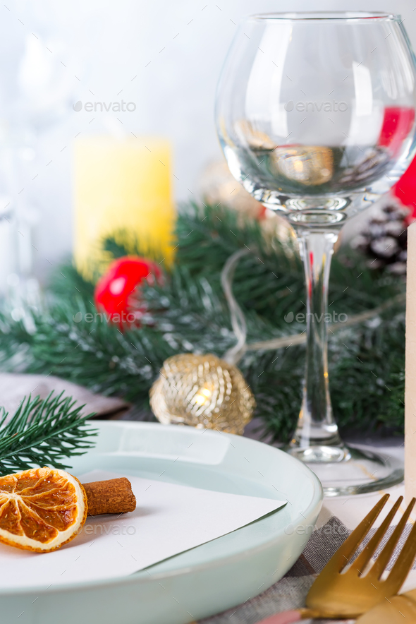 Festive Christmas and New Year details table setting with dry orange and wine glass on a gray - Stock Photo - Images
