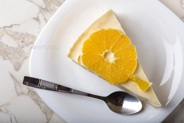 One slice of homemade orange cake - Stock Photo - Images