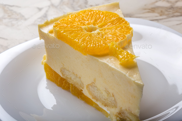 slice of homemade orange cake on plate - Stock Photo - Images