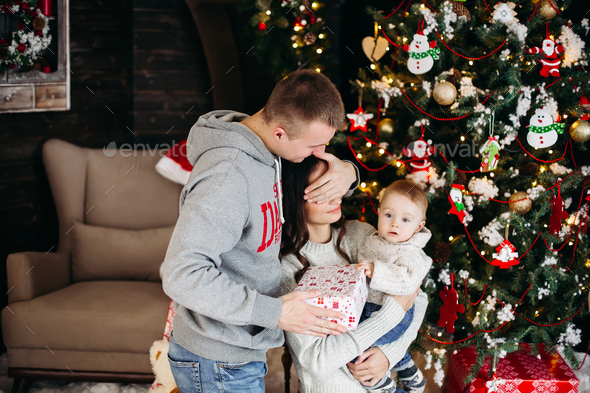 Happy family opening christmas presents with children - Stock Photo - Images