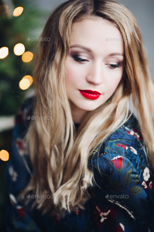 Portrait of beautiful woman having make up and red lips - Stock Photo - Images