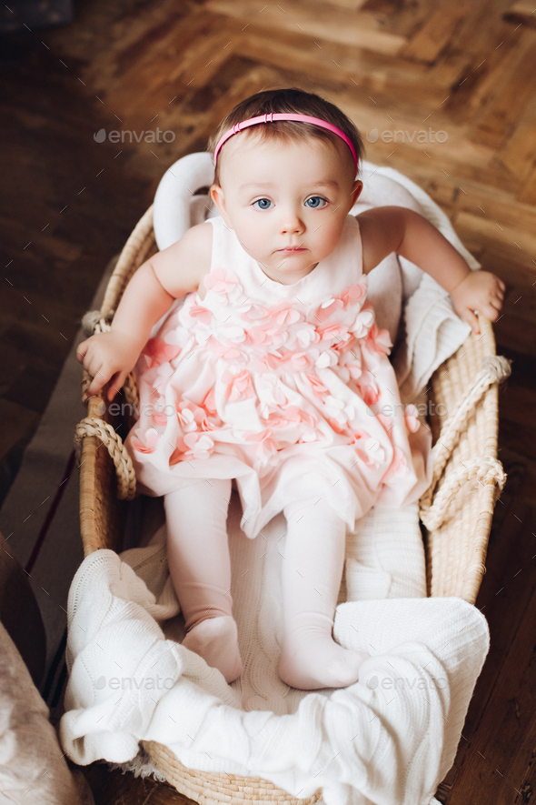 View from above of sweet little cute girl in cute pink dress - Stock Photo - Images