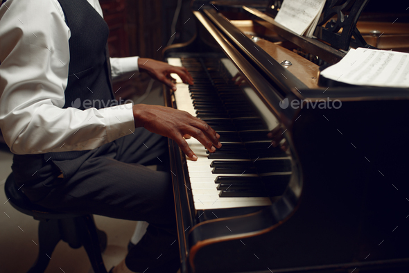 Ebony pianist, jazz performer on the stage - Stock Photo - Images