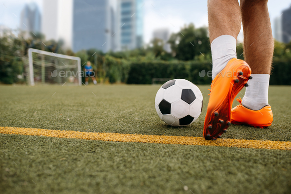 Male soccer player working with ball on the field - Stock Photo - Images