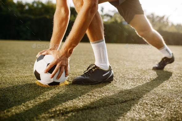 Male soccer player prepares to hits the ball - Stock Photo - Images