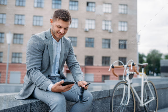 One businessman with cycle at office building - Stock Photo - Images