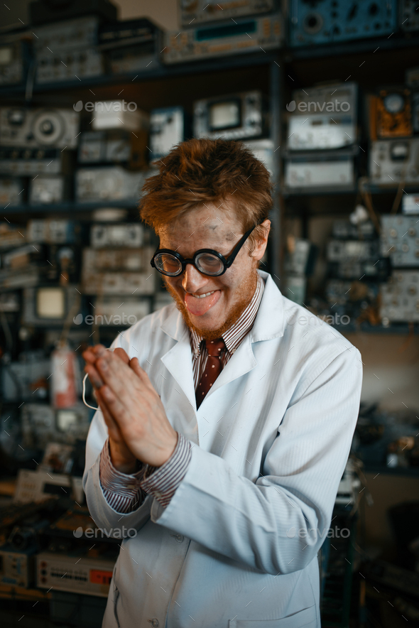Crazy male scientist conducts a test in laboratory - Stock Photo - Images