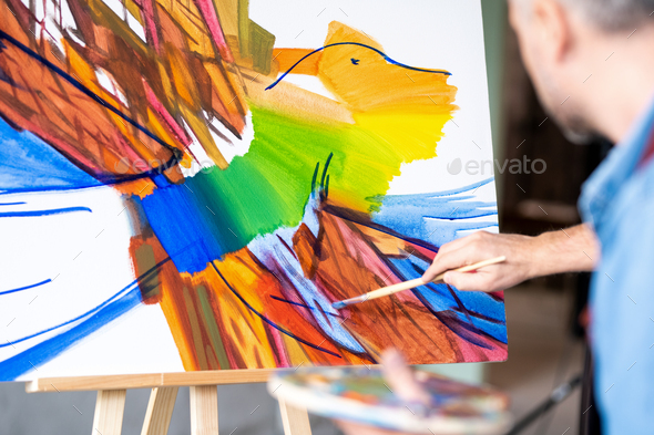 Part of abstract painting on sheet of paper and hand of artist with paintbrush - Stock Photo - Images