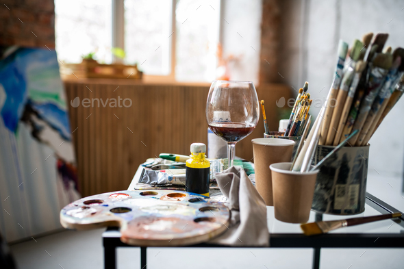 Workplace of contemporary professional painter inside studio of arts - Stock Photo - Images