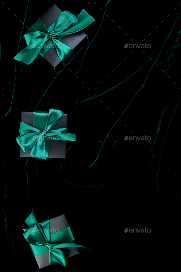 Luxury black gift boxes with green ribbon - Stock Photo - Images