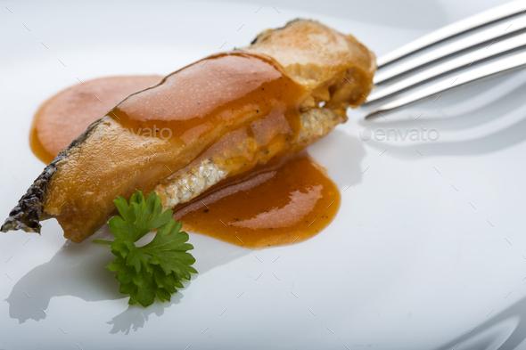 Marinated herring fish in tomato sauce - Stock Photo - Images