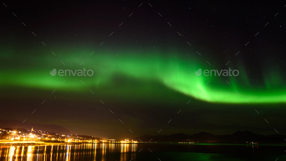 A beautiful green Aurora borealis or northern lights in the sky at Tromso, Norway - Stock Photo - Images