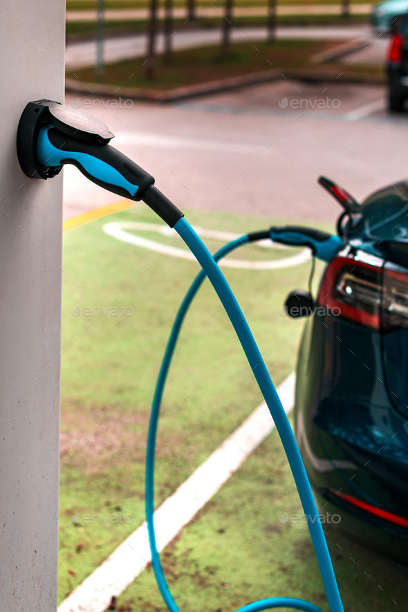 Electric vehicle charging station point - Stock Photo - Images