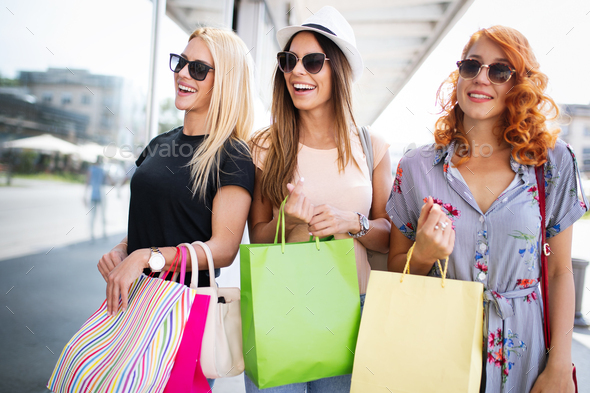 Beautiful women with shopping bags walking at the mall - Stock Photo - Images
