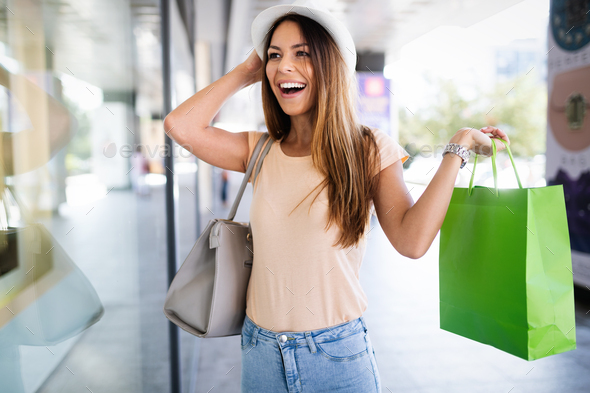Beautiful shopping happy woman holding shopping bags - Stock Photo - Images