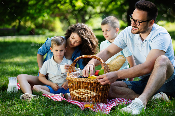 Young family with children having fun in nature - Stock Photo - Images