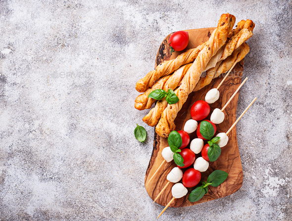 Caprese skewers and grissini bread - Stock Photo - Images